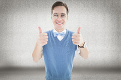 Composite image of geeky young hipster smiling at camera Royalty Free Stock Images