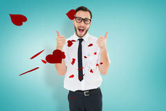 Composite image of geeky young man showing thumbs up Stock Photography