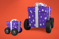 Composite image of gift box with gray ribbon on wheels Royalty Free Stock Images