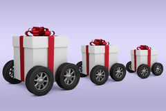 Composite image of gift box with red ribbon on wheels Royalty Free Stock Photos