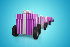 Composite image of gift box with wheel Royalty Free Stock Photo