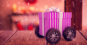 Composite image of gift on wheels Royalty Free Stock Photos