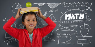 Composite image of girl carrying books and apple on head Stock Photography
