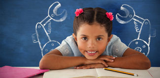 Composite image of girl clenching teeth while leaning on book. Girl clenching teeth while leaning on book against blue background Stock Photography