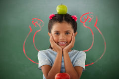 Composite image of girl with granny smith apple on head Stock Images