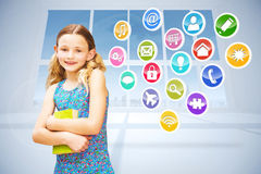Composite image of girl holding book in library Stock Images
