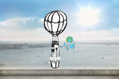 Composite image of girl in hot air balloon blowing earth bubbles Royalty Free Stock Image
