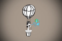 Composite image of girl in hot air balloon blowing earth bubbles Royalty Free Stock Photo