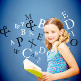 Composite image of girl reading book in library Stock Photos