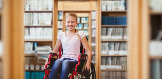 Composite image of girl sitting in wheelchair in school corridor Royalty Free Stock Photography