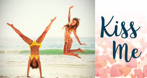 Composite image of girls on beach jumping and valentines words. Composite image of girls on beach jumping against backgrounds working Royalty Free Stock Images