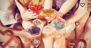 Composite image of girls with cocktails toasting Stock Photo