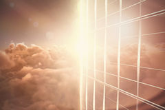 Composite image of glass building on sunny day Stock Photo