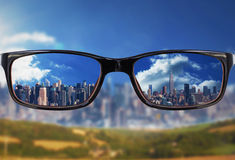 Composite image of glasses. Glasses against city on the horizon Royalty Free Stock Images
