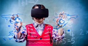 Composite image of global business interface. Global business interface against boy using a virtual reality device Royalty Free Stock Photos