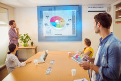 Composite image of global business interface. Global business interface against creative business team making presentation Stock Photo