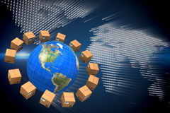 Composite image of globe amidst brown boxes. Globe amidst brown boxes against glowing world map on black background stock photography