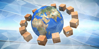 Composite image of globe amidst brown cardboard boxes. Globe amidst brown cardboard boxes against abstract glowing black background royalty free stock images