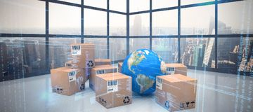 Composite image of globe with cardboard boxes. Globe with cardboard boxes against room with large window showing city royalty free illustration
