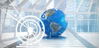 Composite image of globe on conveyor belt. Globe on conveyor belt against binary codes and lines royalty free stock photography