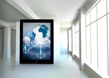 Composite image of globe and figures on tablet screen. Globe and figures on tablet screen against white room with screen Royalty Free Stock Photos