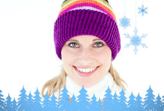 Composite image of glowing young woman wearing white pullover and colorful hat Stock Photos