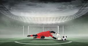 Composite image of goal keeper holding soccer ball in stadium. Digital composite of Composite image of goal keeper holding soccer ball in stadium stock photo