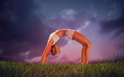Composite image of gorgeous fit blonde in crab pose Royalty Free Stock Image