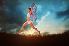 Composite image of gorgeous fit blonde leaping with scarf Stock Photo
