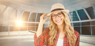 Composite image of gorgeous smiling blonde hipster posing Royalty Free Stock Photo