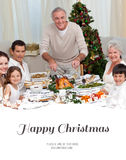 Composite image of grandfather cutting turkey for christmas dinner Stock Photos