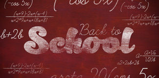 Composite image of graphic image of back to school text. Graphic image of back to school text against brown blackground Stock Photo