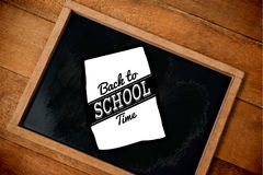 Composite image of graphic image of back to school text on paper Stock Photo