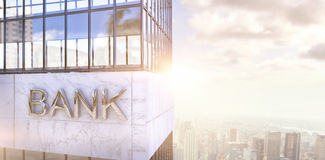 Composite image of graphic image of bank building. Graphic image of bank building against image of a city landscape on a sunny day Stock Images