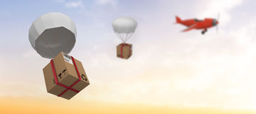 Composite image of graphic image of 3d parachute carrying cardboard box Stock Photos