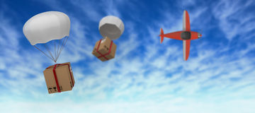 Composite image of graphic image of 3d parachute carrying parcel Stock Photos