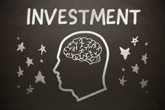 Composite image of graphic image of human head with brain amidst star shapes below investment text Royalty Free Stock Image