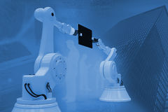 Composite image of graphic image of robots with computer tablet 3d. Graphic image of robots with computer tablet against view of data technology 3d Royalty Free Stock Image