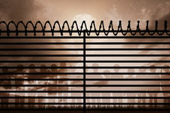 Composite image of graphic image of spiral barbed wire on fence Royalty Free Stock Photography