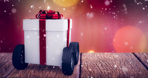 Composite image of gray gift box with wheels Royalty Free Stock Image