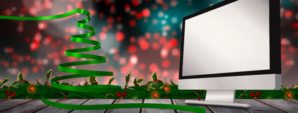 Composite image of green christmas tree ribbon Stock Image