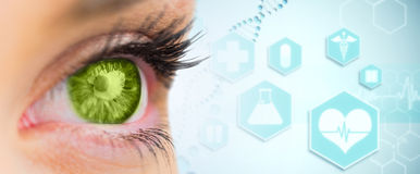 Composite image of green eye looking ahead Royalty Free Stock Photography