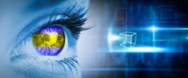 Composite image of green and yellow eye on blue face. Green and yellow eye on blue face against blue technology design with cube royalty free stock images