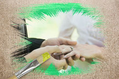 Composite image of groom placing ring on brides finger Stock Images