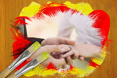 Composite image of groom placing ring on brides finger Stock Image