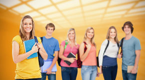 Composite image of a group of college students standing as one girl stands in front of them Stock Images