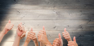 Composite image of group of hands giving thumbs up Royalty Free Stock Image