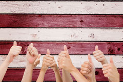 Composite image of group of hands giving thumbs up Royalty Free Stock Images