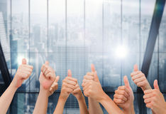 Composite image of group of hands giving thumbs up Stock Image