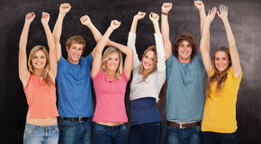 Composite image of a group of people with their hands raised Royalty Free Stock Photography
